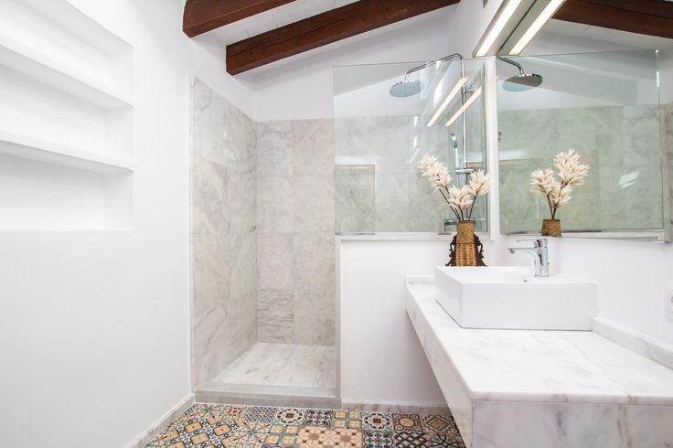 Lovely floor tiles in this amazing bathroom!