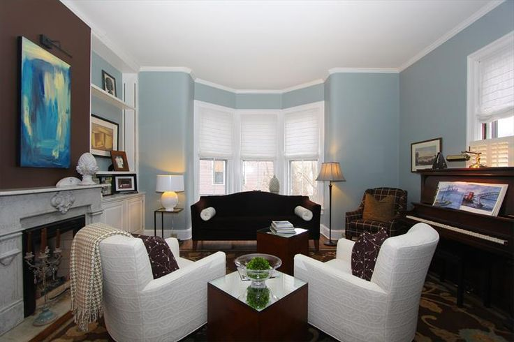224 Wilmuth Ave Wyoming, OH 45215 #bluepaint #brownpaint #contemporarychairs #Victorian #fireplace #livingroom