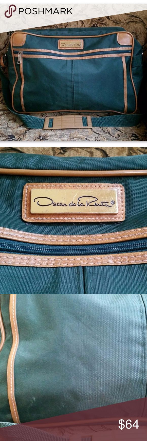 Oscar de la Renta Vintage Travel Bag 100% Authentic Oscar de la Renta Travel Bag! True Vintage travel bag made exclusively for Oscar de la Renta by H. Rosenfeeld Luggage. Large nylon duffle bag with brown PVC/leather trim and large logo plate on front. Adjustable shoulder strap with padding. Top zip closure. Large front pocket and luggage tag holder at side. Signature logo print lining. Handsome vintage bag perfect for men or women.  Good condition - light wear on exterior (small marks…