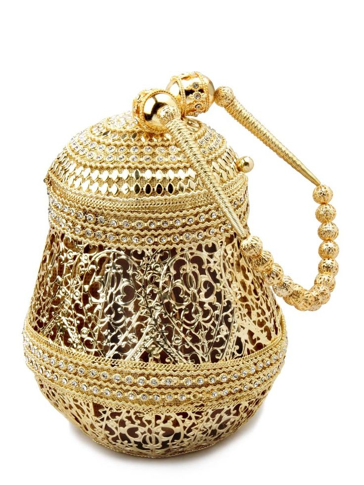 Spectacular golden color brass metal potli purse decorated with glittering diamantes. Item Code: SJBP2003  http://www.bharatplaza.com/new-arrivals/accessories.html