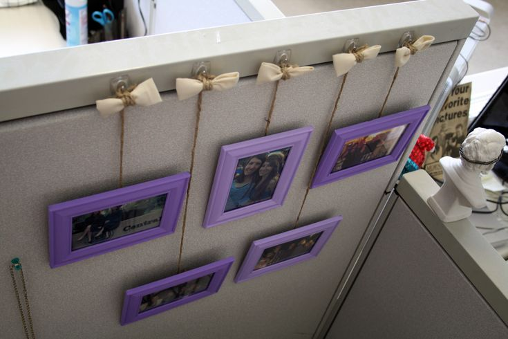 Cute idea to hang picture frames in cubicle