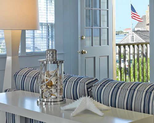 Nantucket cottage. Like the blue, and curtains could be stripes like these chairs?