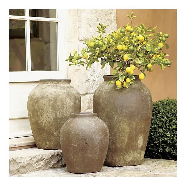"""Moss Olive Jars. """"Terra cotta and finished with natural earth pigments. The massive scale of this architectural object is enhanced by a rich, rustic green oxidized finish to create the effect of an ancient artifact."""""""