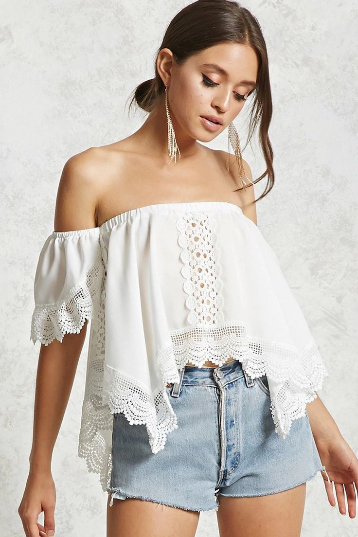A woven cropped top featuring an elasticized off-the-shoulder neckline, a scalloped crochet trim, semi-sheer crochet center and side inserts, a handkerchief hem, and short sleeves.