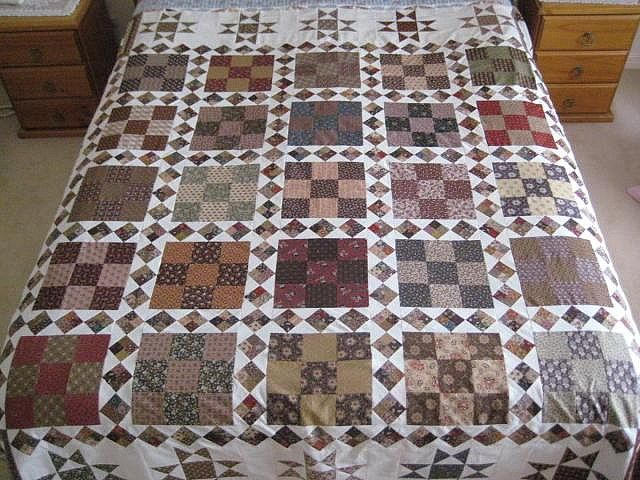 Civil War print quilt. I really love the inside 4-patch sashings! Lovely!