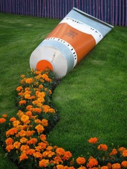 This would be cuter with a pot turned on it's side with marigolds growing from it as shown, instead of the tube.
