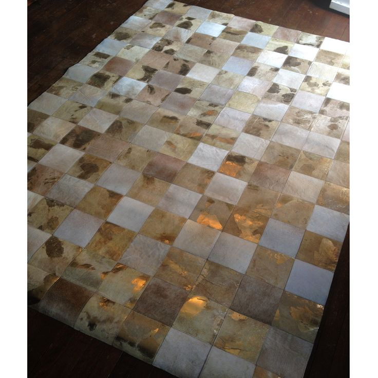 Must have!    A strikingly unusual and beautiful rug made up of patchworked natural cowhide and embellished with splashes of luxurious metallic gold - each one totally unique.