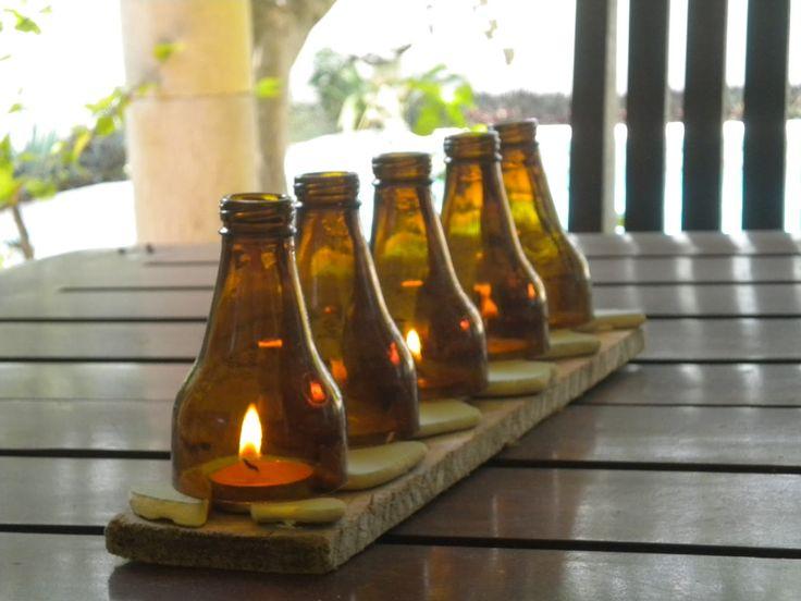 Best 25 beer decorations ideas only on pinterest beer for Glass bottle centerpieces