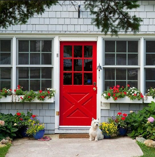 Grey shingles, red door.