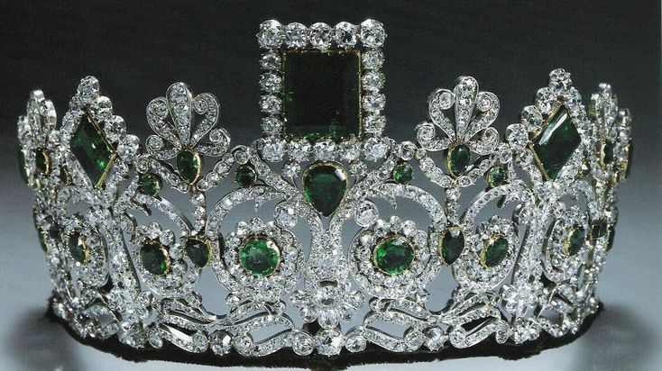 This tiara originates with Empress Joséphine, first wife of Napoléon Bonaparte. It was made for her by the French jeweler Bapst, and is part of a parure that today includes a necklace, earrings, and two brooches. This symmetrical diadem incorporates geometric emeralds in a neo-classical diamond design, all mounted on a frame of gold and silver.