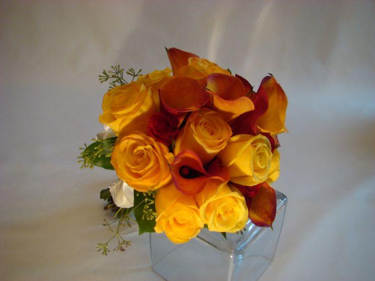 Bridal bouquet of yellow roses and mango mini calla lilies. www.plushflowers.ca