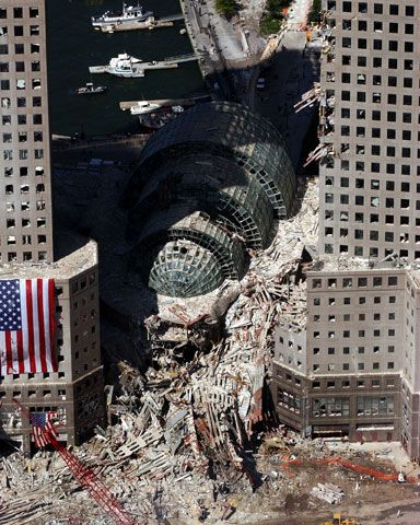 An aerial view on Sept. 17 2001, shows the debris-clogged Winter Garden between the buildings of the World Financial Center near the World Trade Center which collapsed following the Sept. 11 terrorist attack. These surrounding buildings were heavily damaged by the debris and massive force of the falling twin towers.