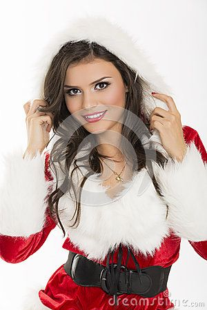 Portrait of beautiful smiling sexy woman Santa Claus helper posing against bright background.