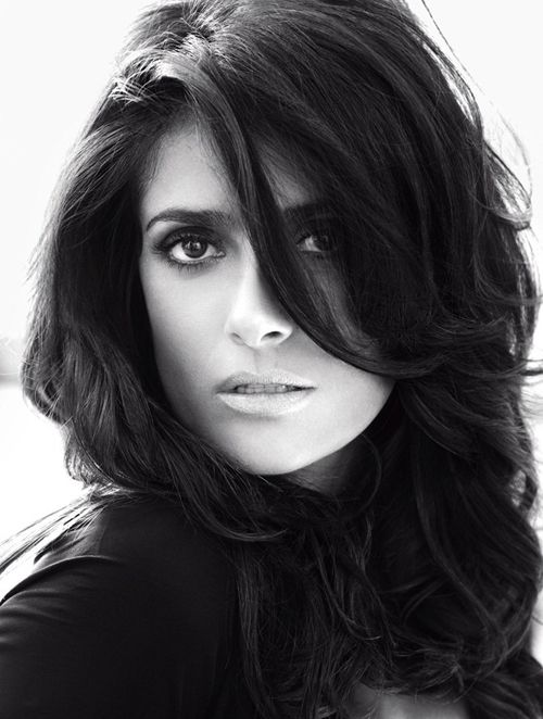 Actress Salma Hayek blows out the sensuality circuits in Vogue Germany's September issue, lensed as a smoldering seductress by Alexi Lubomirski.