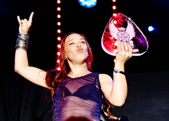 The first-ever female air-guitar champion was crowned in the UK. | 18 Badass Women You Probably Didn't Hear About In 2014