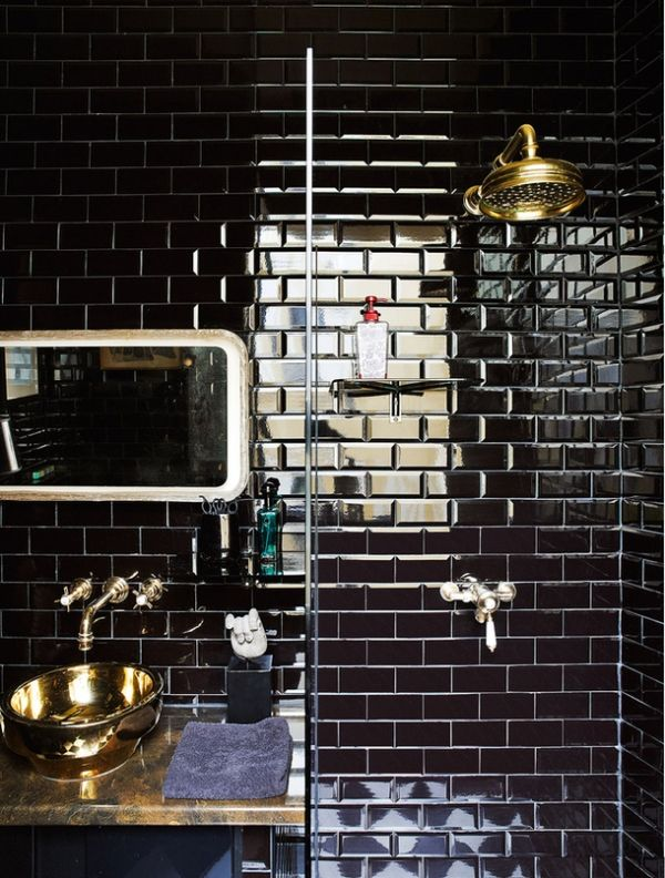 Black subway tiles. Gold fixtures and vessel sink. Bathroom design. Lux chic