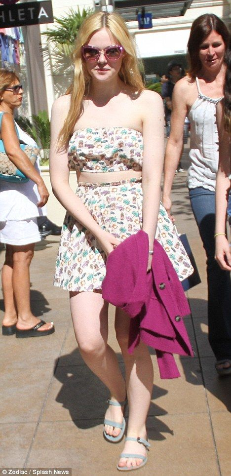 #ElleFanning #fashion and #movies   Clinging on to normal life: Rising star Elle Fanning hits the shops in flared Fifties number