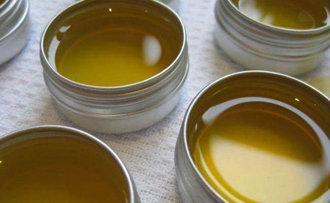 g beeswax  2 g carnauba wax 15 g sesame seed oil 10 g coconut oil 10 g castor oil 40 g jojoba oil (grapeseed or olive oil can also be used as an alternative) 10 drops of essential oils of your choice. (grapefruit, lemon, sandalwood or ylang-ylang oil are great for this recipe) Directions  MELT the wax in a pot. STIR, turn down the heat, and slowly add the blend of essential oils. If the wax hardens before everything is mixed, gradually increase the heat. POUR the mixture into a glass jar…