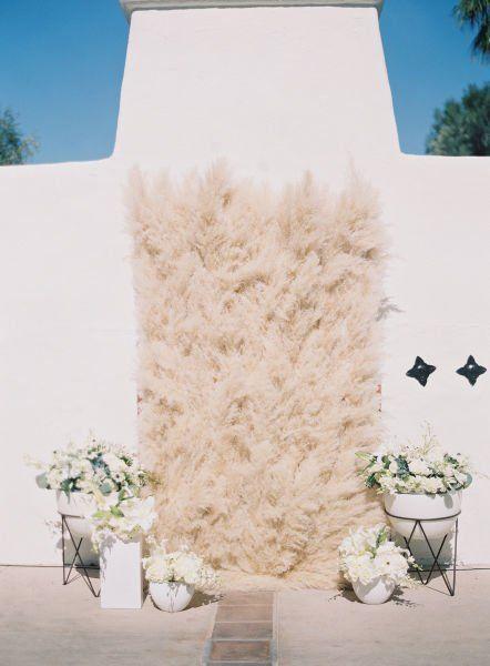 Boho-chic wedding ceremony decor idea - textured wall of pampas grass  {Sposto Photography}