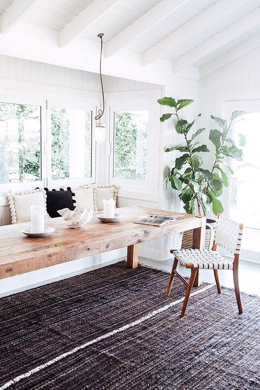 Kitchen Banquette With Black And White Pom-pom Pillows And