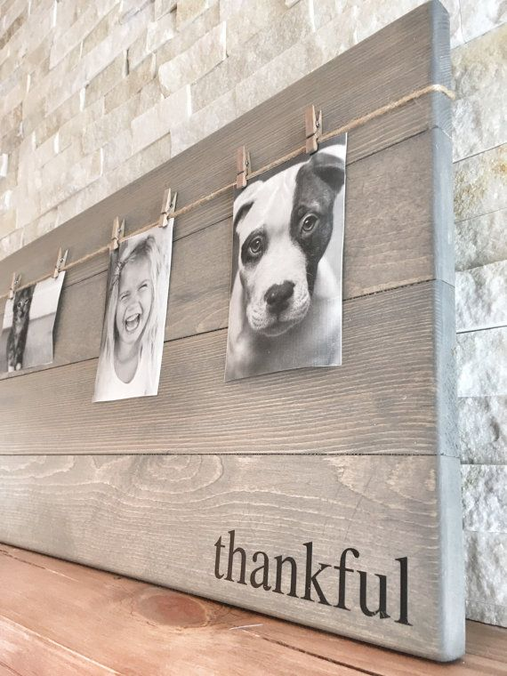 This unique picture frame can easily become the focal point in any room with the word thankful, grateful or blessed! Such a beautiful and rustic way to display you and your loved ones memorable photos and it makes switching out pictures a breeze! These wood photo frames would make a great gift!  This listing is for one photo wood board with the word of: thankful, grateful or blessed  Measurements: photo wood board has eight clothespins hanging from twine and is L: 30 x W: 14  This photo…