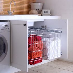 Laundry Storage solution - Stainless steel wireware baskets, available in various sizes. More info via www.tansel.com.au