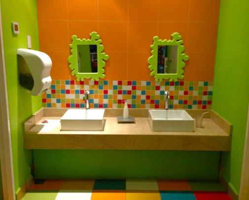 Playful Fisher-price kid's bathroom at the Kids club center. I love the idea of having neat shaped mirrors in the kids bathroom!