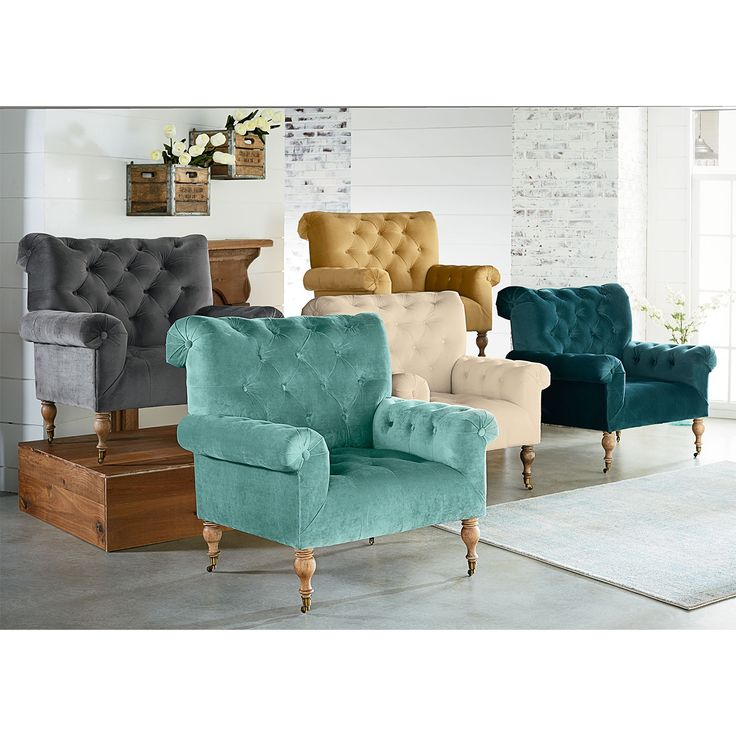 Comfortable and colorful, the upholstered Carpe Diem Accent Chair is just that. It features a grand club chair look with wide rolled arms and back, deep button tufting and turned wooden legs on casters. Magnolia Home curated by Joanna Gaines.