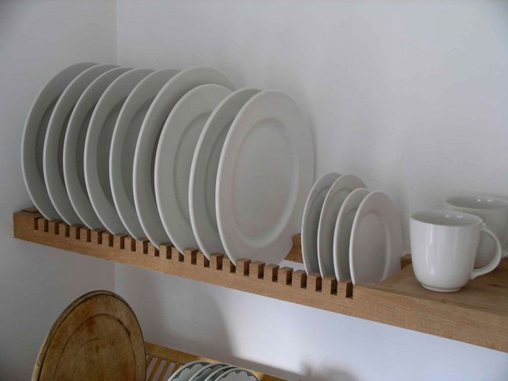 Place inside cabinet if room, or on a wall if trying to create space. | 25 Best Ideas About Plate Racks On Pinterest Cabinet Rack
