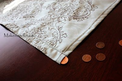 Then a little trick if you're using flimsy fabric that blows around and doesn't hang nicely…. Hem the bottom of your curtain, but with enough room to slide pennies in. Then slide  the pennies all along the bottom hem. I used about 20. Maybe 25. Decorate My Home, Part 1 – Simple Curtains | Make It and Love It