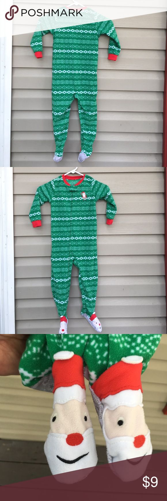 Carter's boys one piece fleece Christmas pajamas NWOT boys Christmas fleece pajamas zip front, with Santa Claus feet 100% polyester no stains, snags or holes. Carters Pajamas