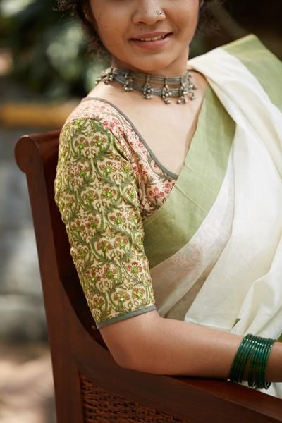 Parrot green embroidery on the sleeve makes regal this simple and elegant blouse kalamkari blouse. The KALAMKARI EDITION Handwoven, designed and tailored...