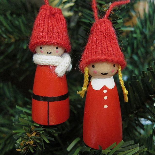 Little Snow People Ornaments---If you don't knit, sometimes you can buy ready-made hats from the dollar store, or make hats out of thick felt.  These remind me of the decorations on my family's tree when I was a little girl.