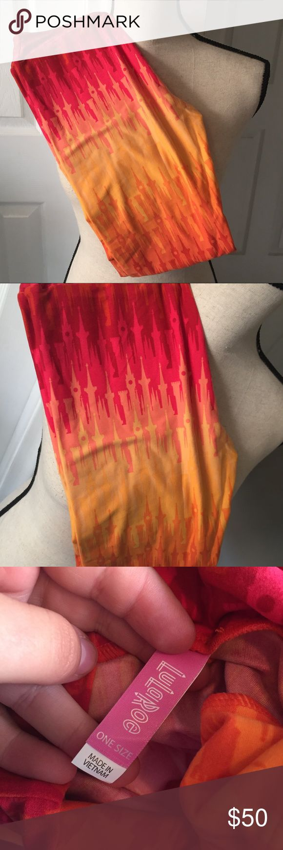 Disney LuLaRoe Castle Leggings New Disney Ombré Castle LuLaRoe leggings in One Size. Colors of reds & oranges . Never worn or tried on, brand new with tags! I'm not a retailer! I just buy too much lula! Price is higher on these because they're hard to find!   Bundle discount available!  🍍Posh Ambassador! 🍍5 Star Rated Seller!  🍍Same or next day shipper! 🐶Pet friendly 🚬Smoke-free 🚫No trades ❌No half price offers LuLaRoe Pants Leggings