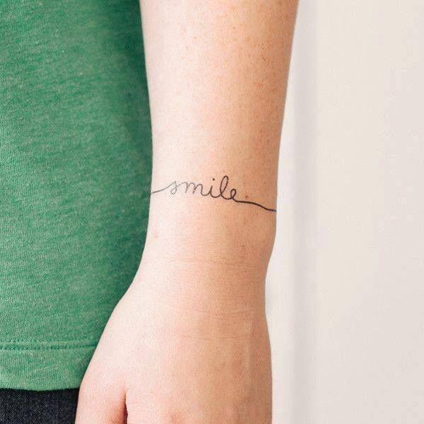 tiny tattoo that remember the importance of smiling - un tatuaggio discreto, per ricordarsi sempre di sorridere alla vita... -