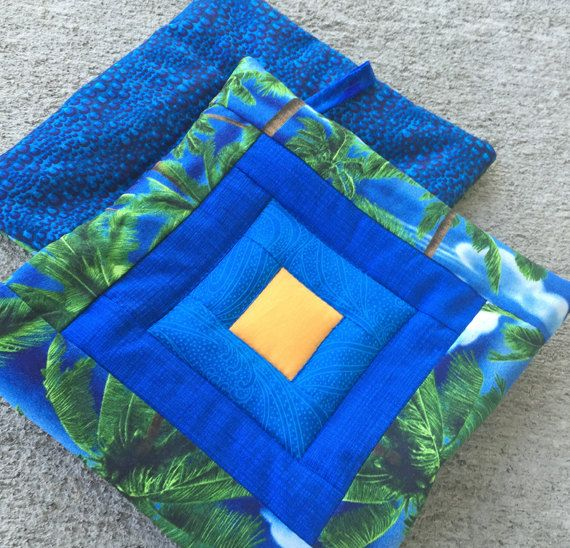 TWO quilted potholders. Handmade hot pads. Fabric by AnnBrauer