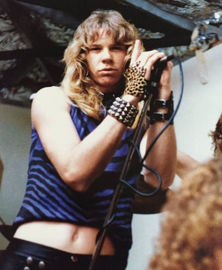 Young James Hetfield, sporting a leopard fingerless glove, a belly shirt, and a very nice studded bracelet...in a classic Jim Morrison pose.