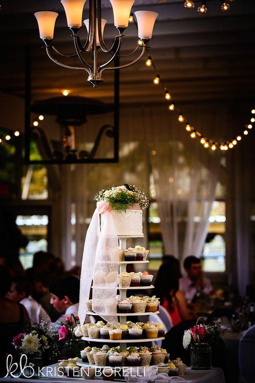 Cupcake and wedding wedding cake. 6 tiers, white.