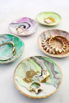 Easy marbled ring dish using Martha Stewart Crafts Liquid Gilding as an accent! From A Beautiful Mess.