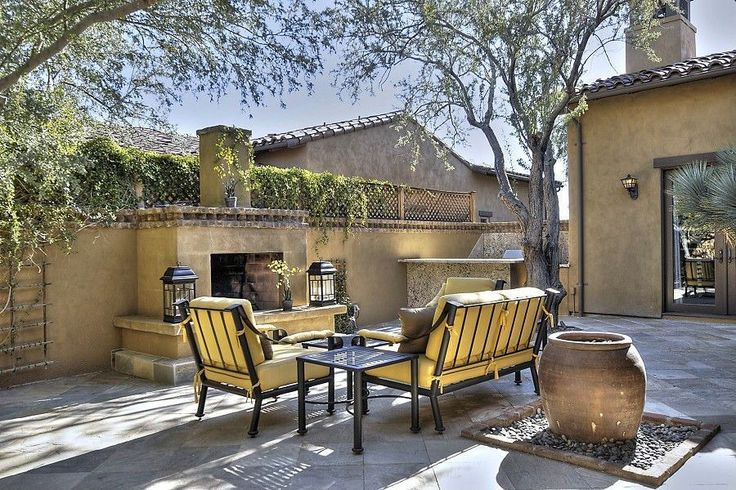 Eclectic Patio with outdoor pizza oven, exterior tile floors, French doors, Fence, Outdoor kitchen