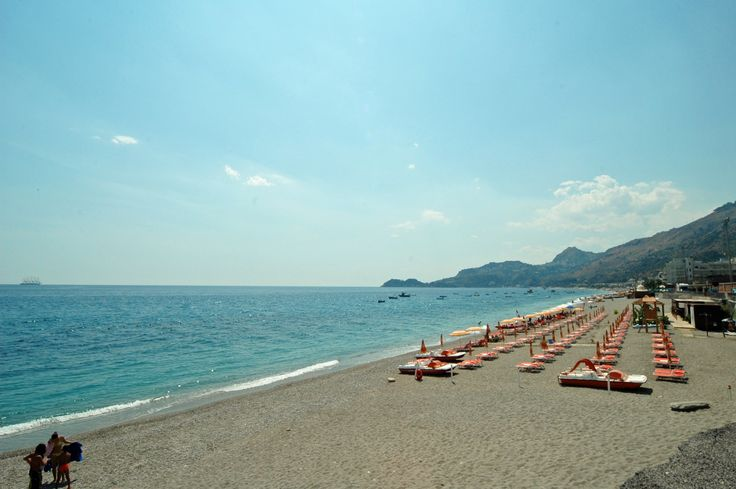 The long sandy-pebbly beach of Letojanni with Taormina in the distance