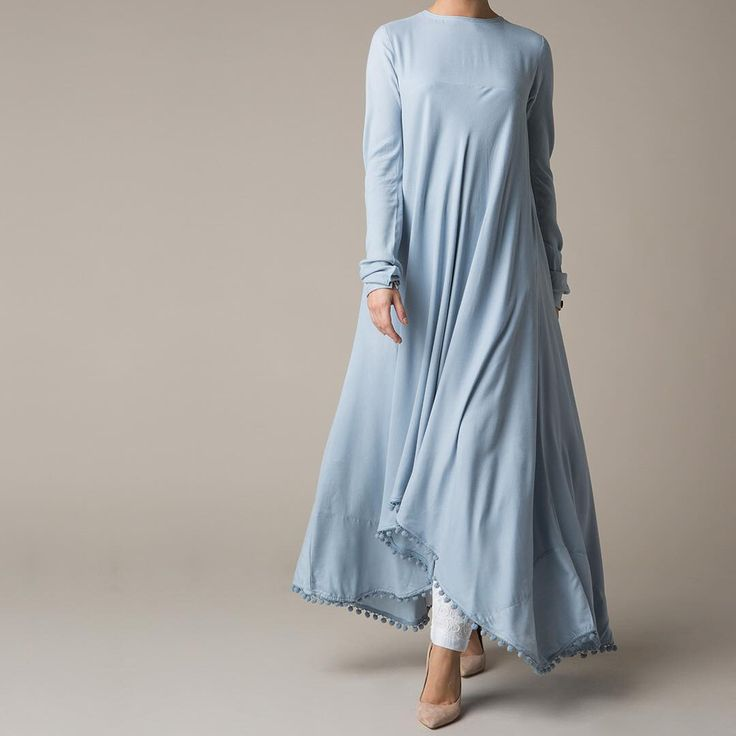 A loose fit silhouette & playful pom-poms perfect for your winter wardrobe. The Bottela Midi. #Aab #hijab #modestdress