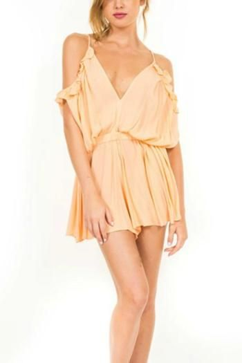 Hippie chic romper featuring ruffle cold shoulder sleeves, flattering elastic waist, and open back. Pair with gladiator sandals and a long necklace.