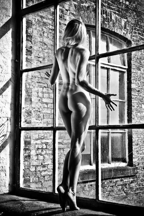 Beautiful B&W Photo Of A Naked Woman Looking Out Of A Window