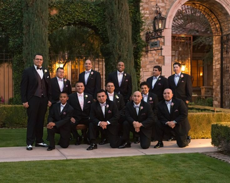The groom and his groomsmen posing in their all black tuxedos out front Villa Siena | villasiena.cc