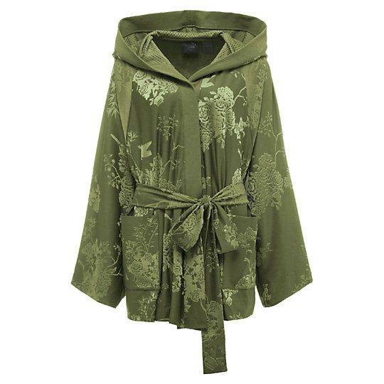 <p>Slay like a heavy-weight—at the gym, in the club, or on your way to bed—with the Boxing & Bomber Robe. Done up in sumptuous custom poly/spandex floral jacquard, with basketball mesh-lined oversized hood, the short, sporty robe is one decadent wrap for the softie in everyone.</p><p>Features</p><ul><li>Custom poly/spandex floral jacquard with PUMA cat detail (robe and sash tie)</li><li>Oversized basketball-mesh-line...