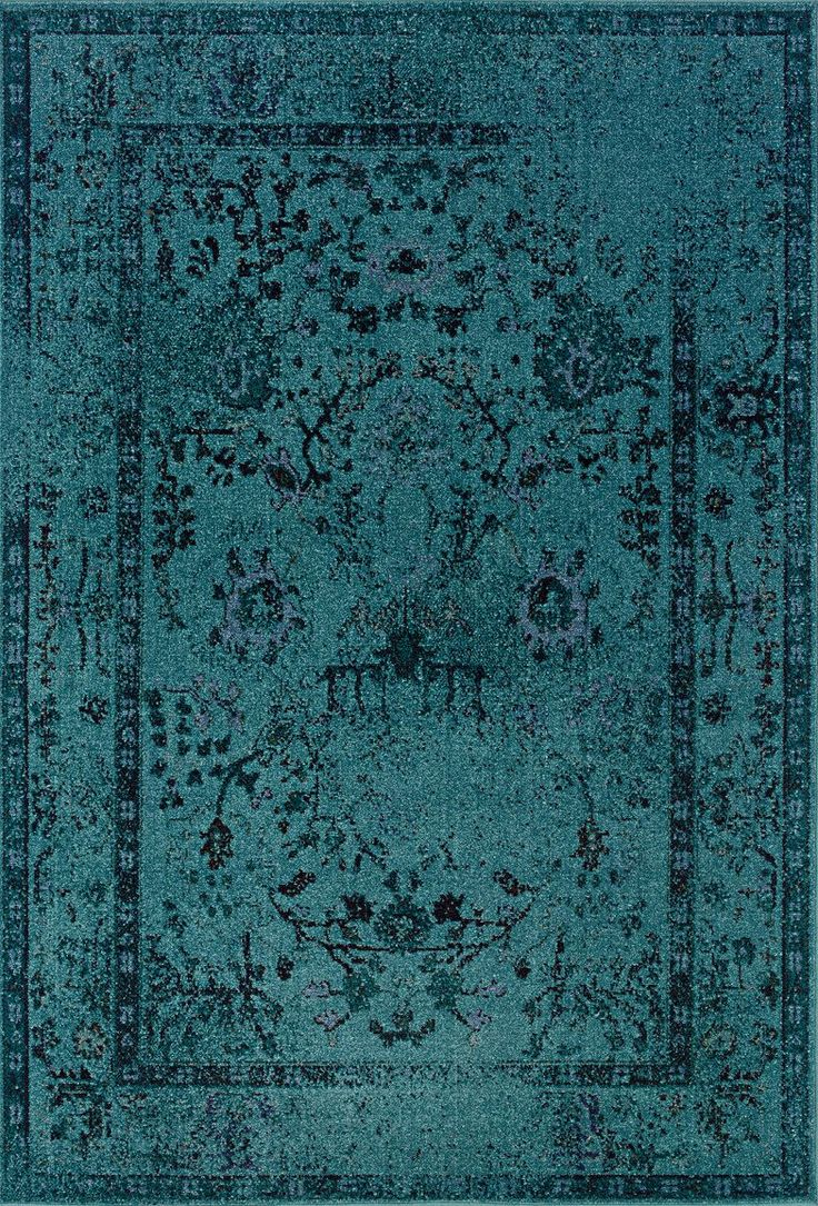 Revival is a unique collection of machine-made rugs which offer easy-care and affordability in one of today's hottest trends. The fashionable over-dyed look is replicated here is washed shades of aqua