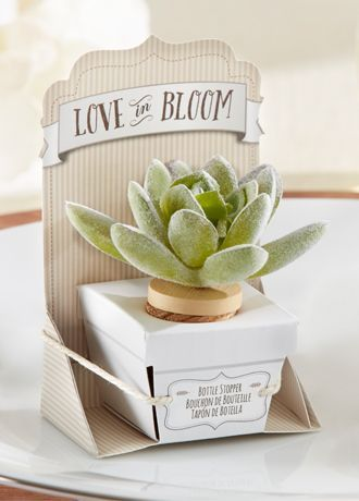 """True love never dies and wine never loses its flavor when guests go home with this creative, eclectic and fabulously faux bloom bottle stopper. The best part? No watering necessary.  Features and Facts:   Measures 2.15""""H x 2.15"""" W.  Fool-the-eye faux cabbage echeveria succulent is flocked plastic with a cork base.  Uniquely packaged like a little plant."""