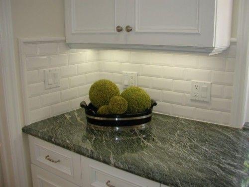 dark green granite with white cabinets