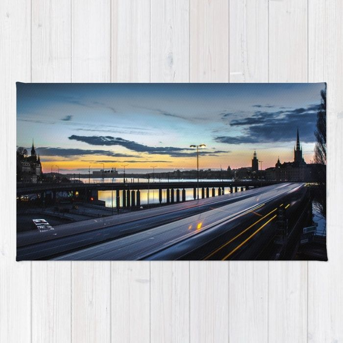 Stockholm Night - Slussen Rug by Nicklas Gustafsson | Society6. A long expo night shot from #Stockholm, #Sweden overlooking the subway and bridges in the #sunset. Taken from #Slussen facing #GamlaStan, #Riddarholmen and #Kungsholmen with the Stockholm City Hall building and the Riddarholm Church. Additional tags; #stadshuset #nightshot #longexposure #longexpo #nightphotography #night #city #train #metro #lighttrails #citylife #rug #homedecor